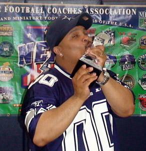 Al Harvey celebrates his victory in NEFL Superbowl XII.
