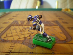 An Adrian Peterson figure designed by Michael Winegarden of Howe, Texas, shows the level of detail hobby enthusiasts are willing to put into the game. Standard game pieces don't have anywhere near this level of detail.
